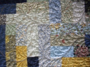 A better look at the feather flurry quilting.