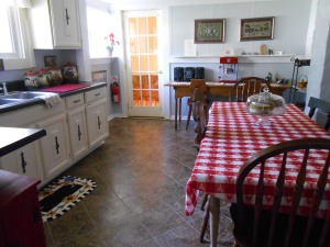 Kitchen upstairs - not a full kitchen - microwave and coffee maker - but a nice big table.